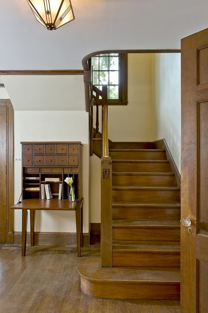 Restored Foyer Stairs traditional-staircase