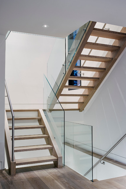 Example of a mid-sized trendy wooden floating open staircase design in Vancouver
