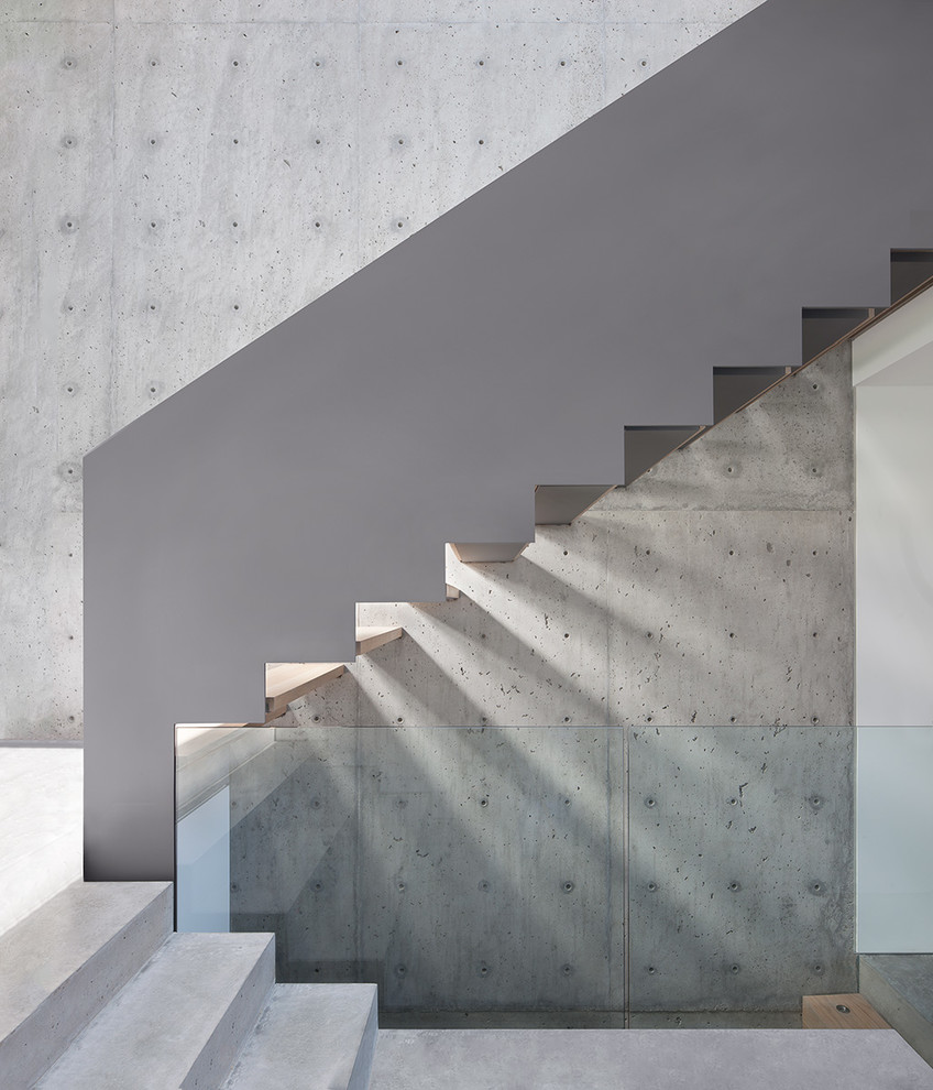 Minimalist wooden u-shaped open staircase photo in Vancouver