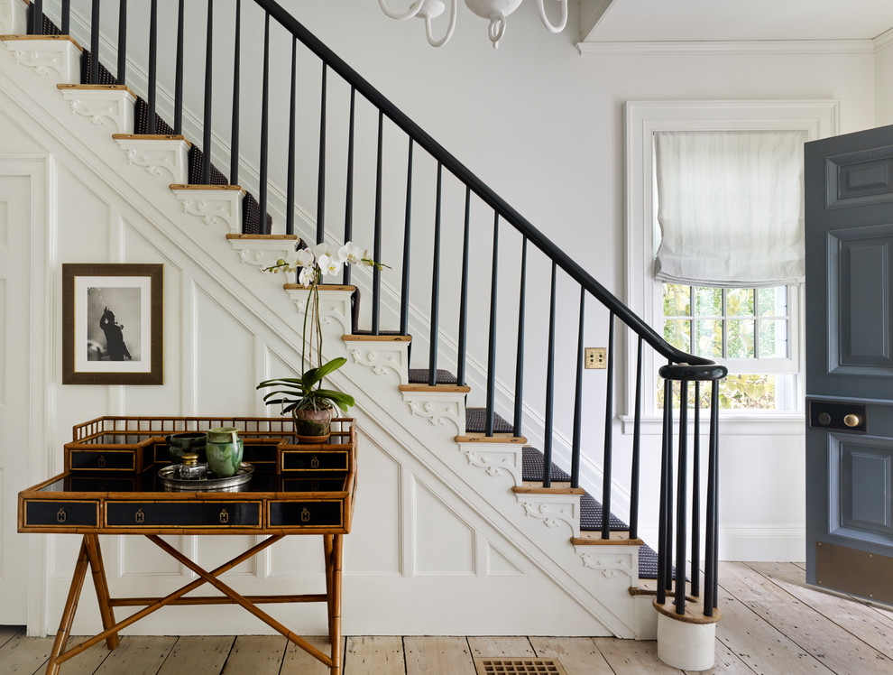 Staircase - mid-sized traditional carpeted straight wood railing staircase idea in New York with wooden risers