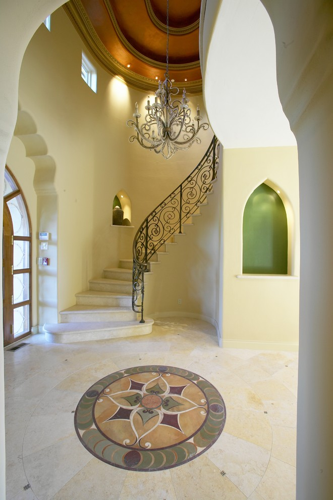 Staircase - mediterranean curved staircase idea in San Francisco