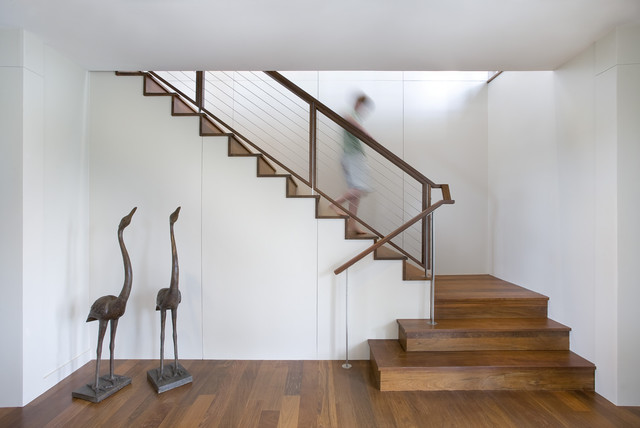 Example Of A Trendy Wooden Staircase Design In Charleston