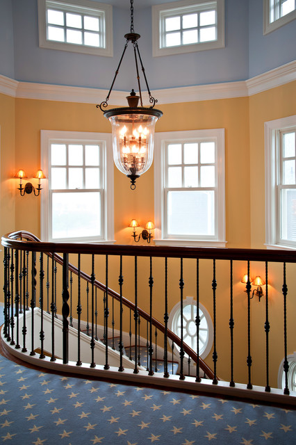 Staircase - traditional carpeted spiral staircase idea in New York with wooden risers