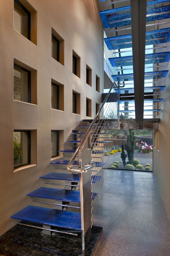Example of a huge southwest glass u-shaped open and cable railing staircase design in Phoenix