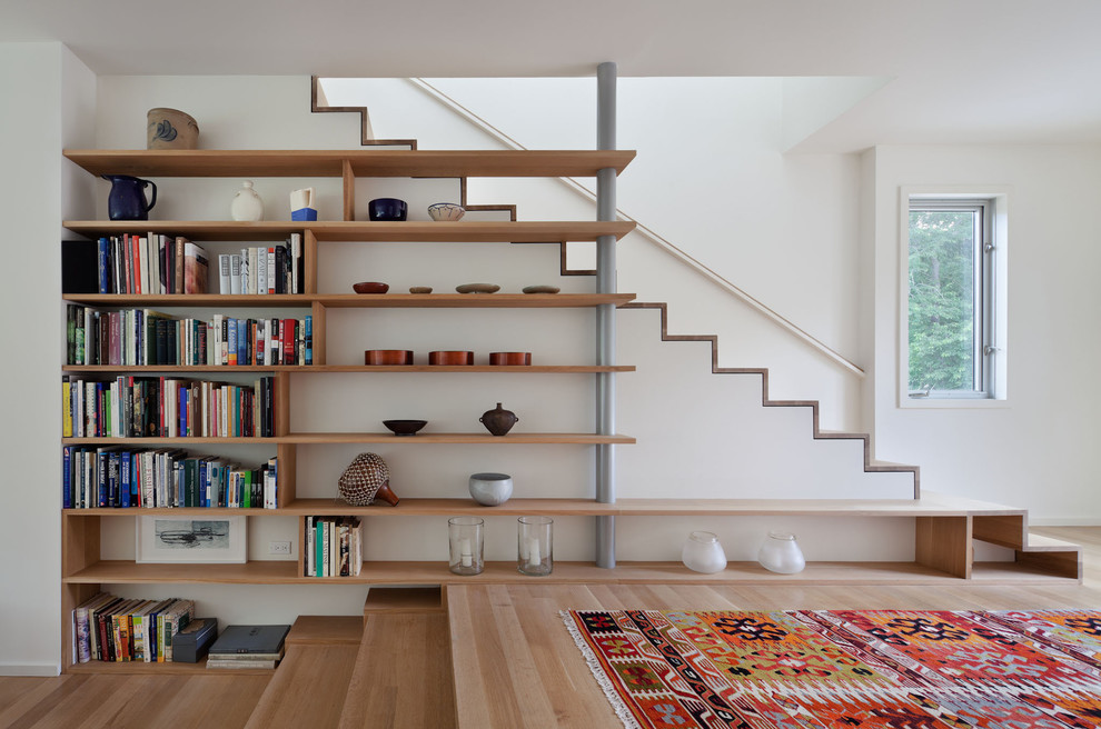 Inspiration for a small contemporary wooden staircase remodel in New York with wooden risers