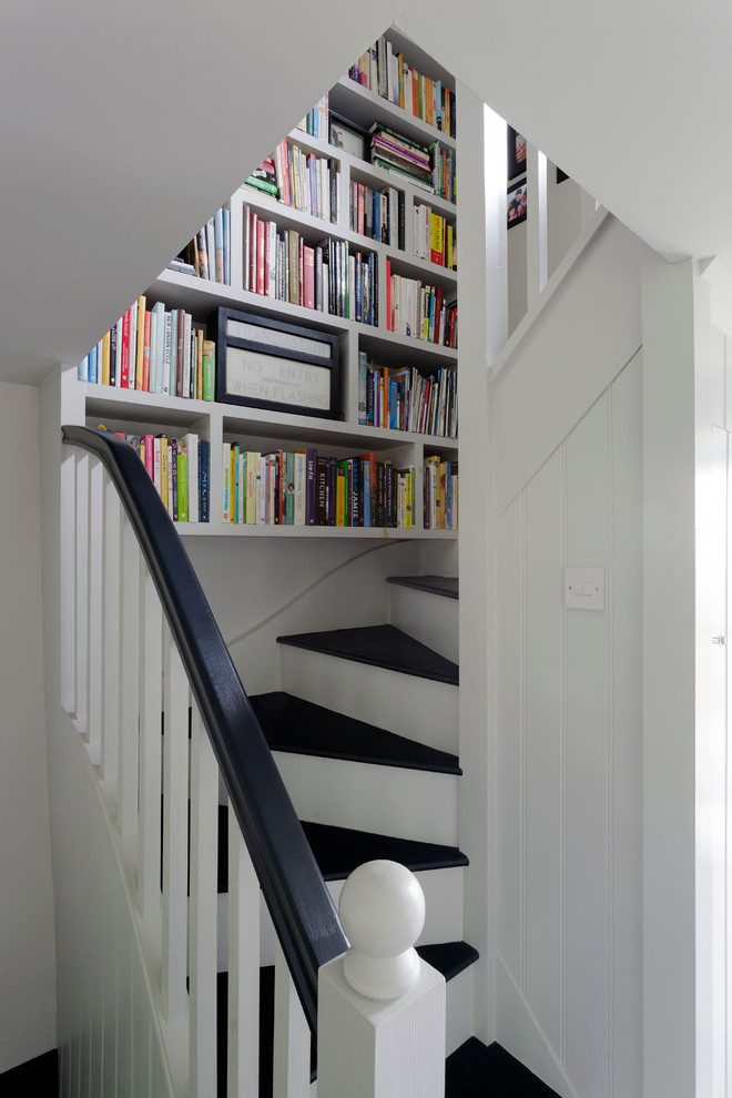 Inspiration for a small farmhouse wooden curved staircase remodel in Cornwall with painted risers