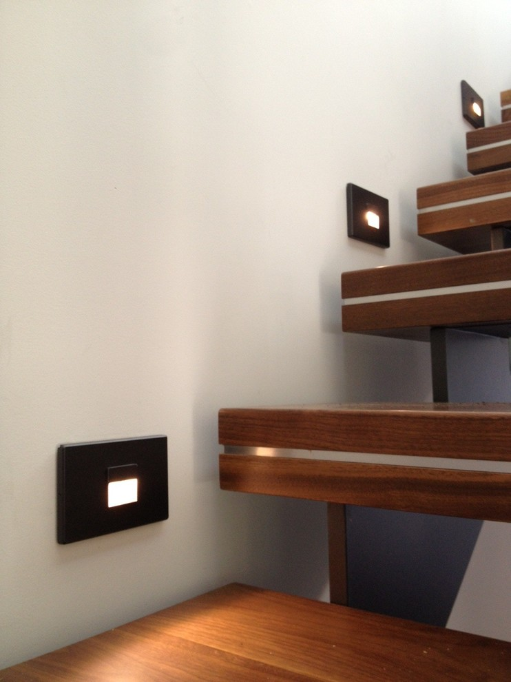 Example of a mid-sized minimalist wooden floating open staircase design in Vancouver