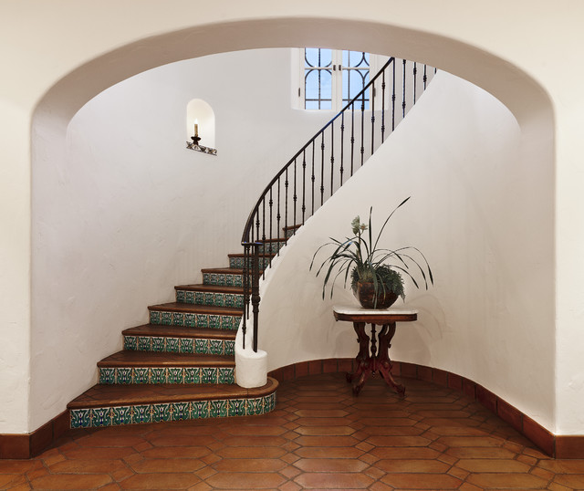 mediterranean staircase by D. D. Ford Construction, Inc