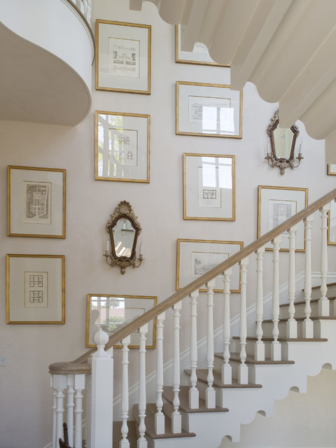 Example of a large classic wooden u-shaped staircase design in Atlanta with painted risers