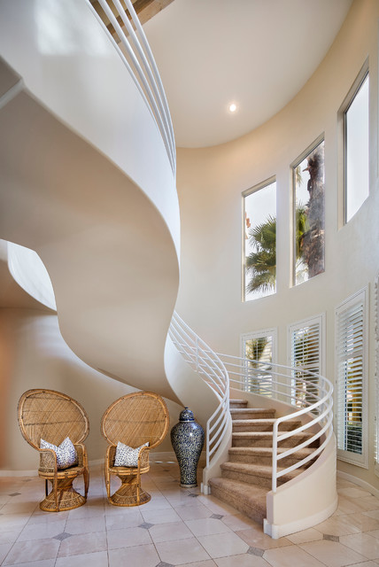 Island style carpeted curved staircase photo in Los Angeles with carpeted risers