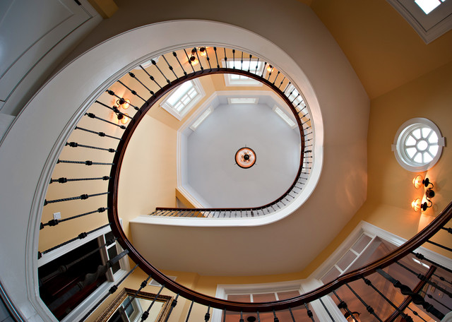 Inspiration for a timeless carpeted spiral staircase remodel in New York with wooden risers