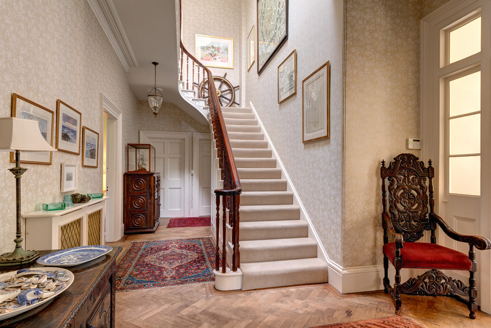 Photo of a traditional carpeted u-shaped staircase in Devon with carpeted risers.
