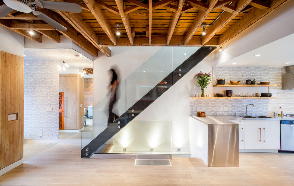 Staircase - industrial glass railing staircase idea in Toronto