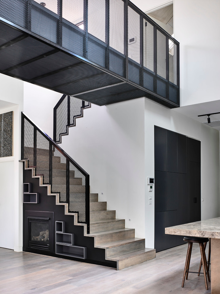 Example of a large trendy wooden u-shaped staircase design in Melbourne with wooden risers