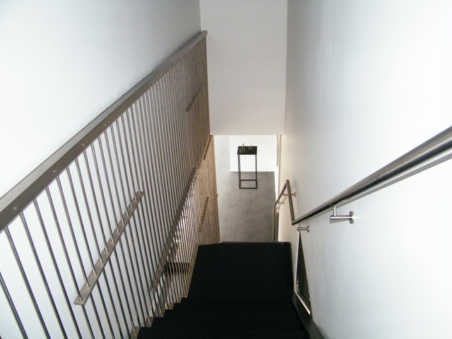Stainless rod railings modern-staircase