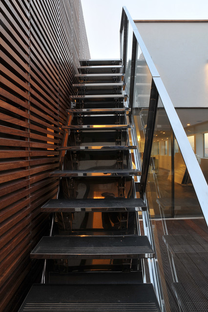 Stainless steel staircase and glass balustrade contemporary-patio