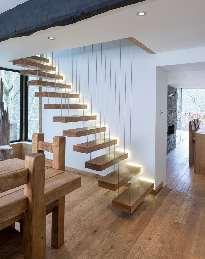 Staircase - contemporary wooden floating open staircase idea in Other
