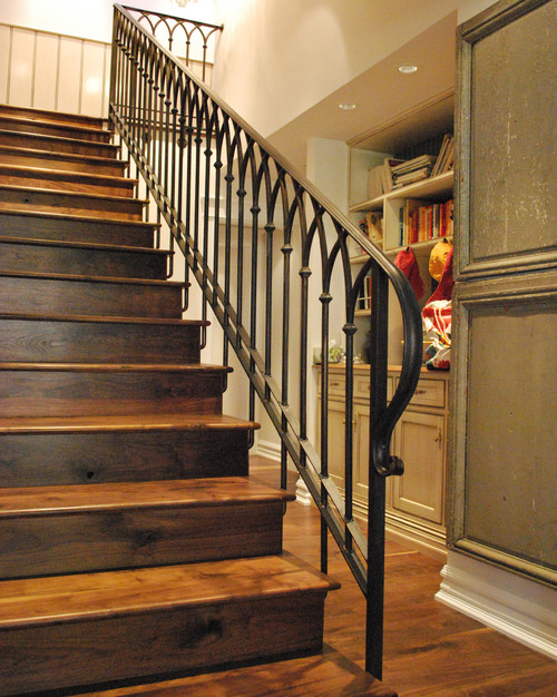 Stair railing designs wood vs iron for Interior iron railing designs