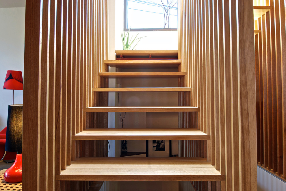 Minimalist floating open staircase photo in Toronto