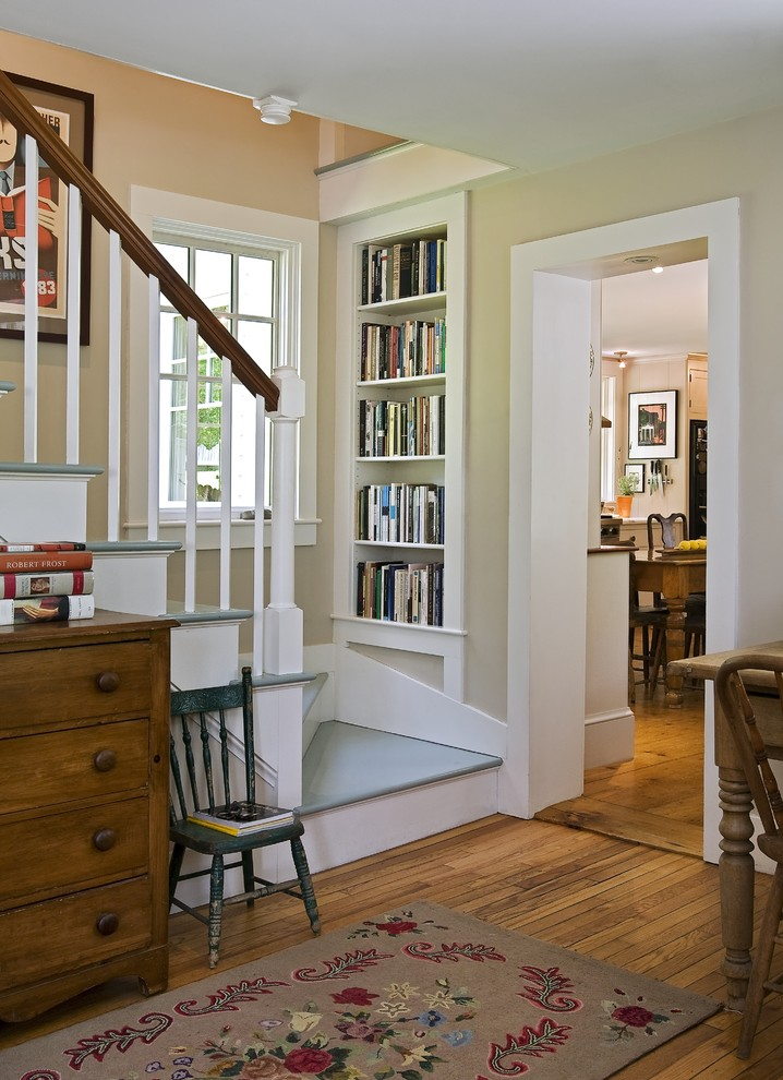 Example of a classic painted staircase design in Burlington with painted risers