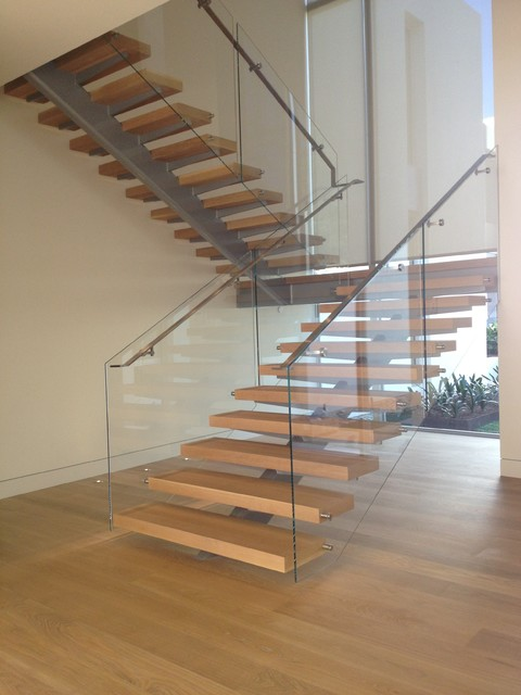 Stairart glass and stainless steel on floating stairs for Free floating stairs