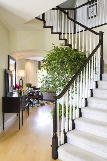 Staircase And Hallway Entry With Cozy Nook Traditional
