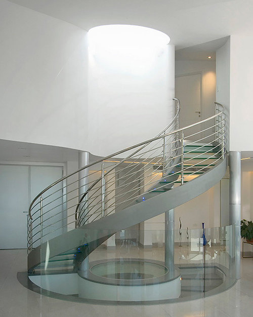 Circular steel staircase with glass treads
