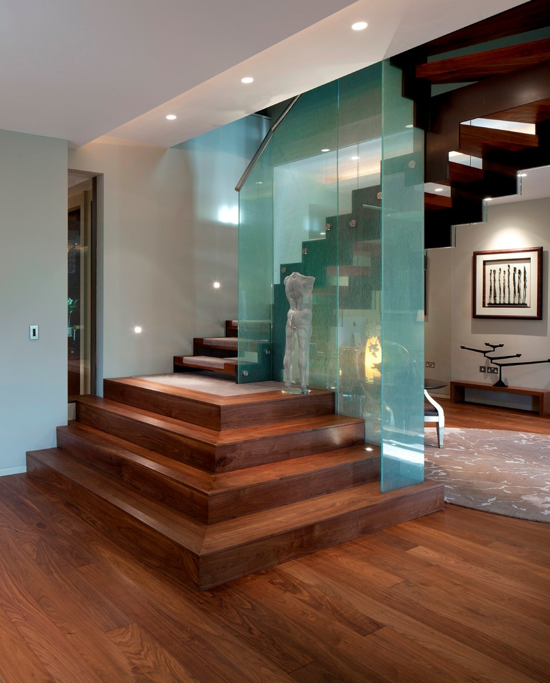 Trendy wooden l-shaped open staircase photo in London
