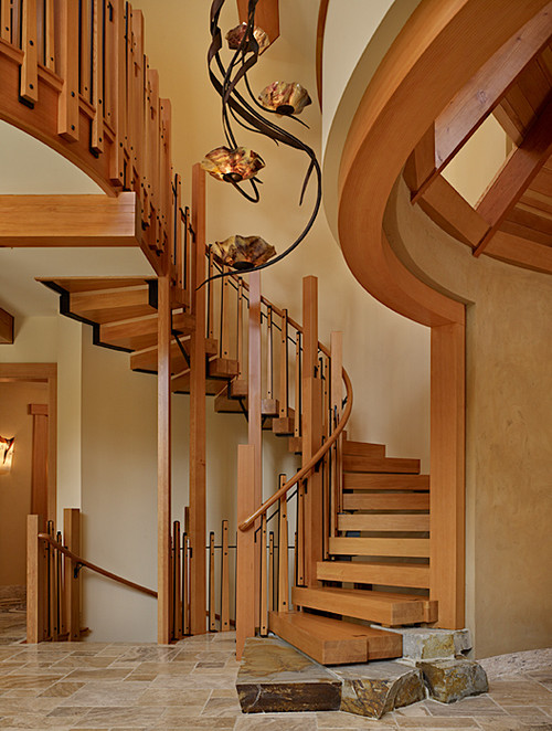 Artistic staircase design thrives in our Cedar Haven custom home.