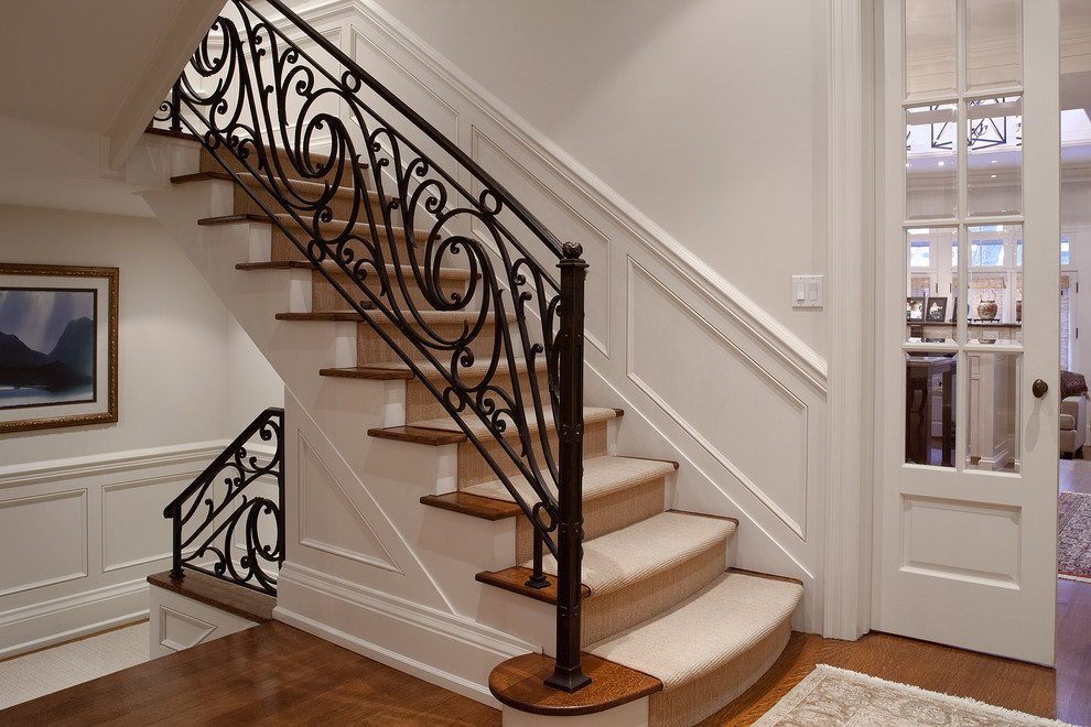 Elegant metal railing staircase photo in Toronto