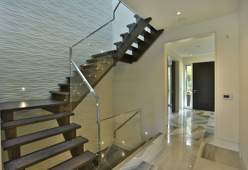 Mid-sized trendy wooden curved open staircase photo in Toronto