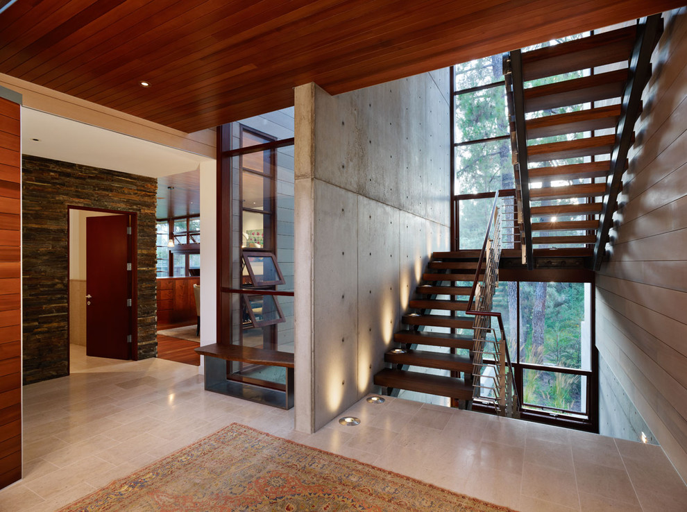 Minimalist wooden u-shaped open staircase photo in Los Angeles