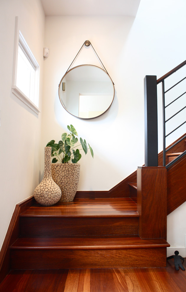 Example of a trendy wooden staircase design in San Francisco with wooden risers