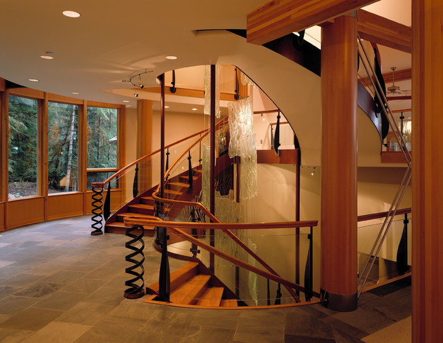 Trendy wooden staircase photo in Seattle