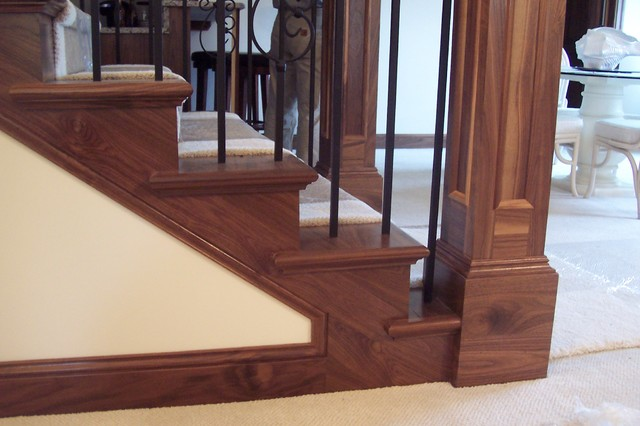 Inspiration for a mid-sized timeless wooden u-shaped staircase remodel in Minneapolis with wooden risers