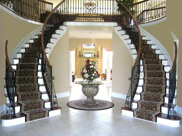 Staircases featuring runners and Zoroufy stair rods traditional-staircase