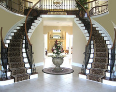 Staircases featuring runners and Zoroufy stair rods traditional staircase