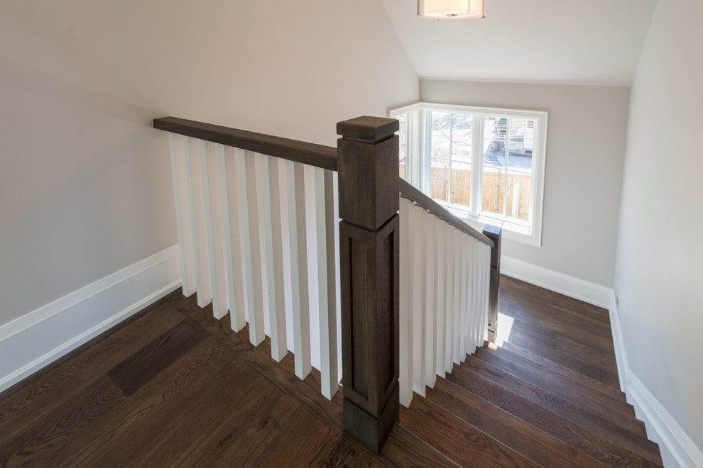 Staircase - transitional wooden u-shaped staircase idea in Toronto with painted risers