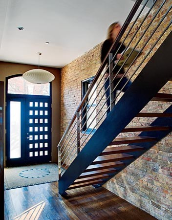 stairs with brick wall contemporary staircase