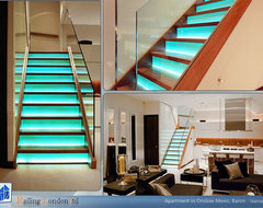 Stairs with glass risers and LED lights modern-staircase