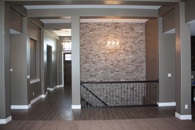 Stairwell Accent Brick Wall Traditional Staircase