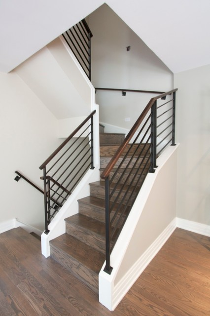 Steel railings with walnut handrails. modern-staircase