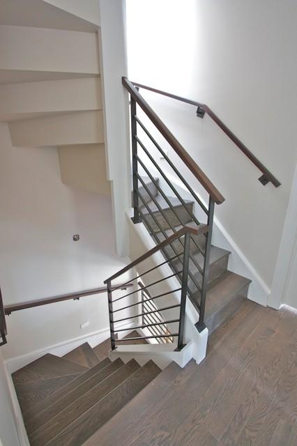 Steel Railings With Walnut Handrails. Modern Staircase