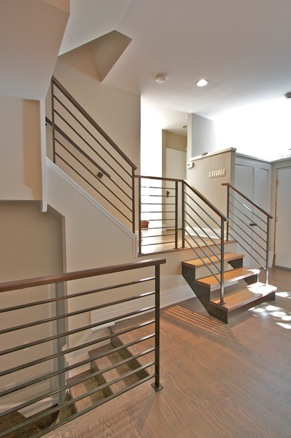 Elegant Steel Railings With Walnut Handrails. Modern Staircase