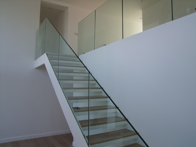 steel staircase with frameless glass balustrade. Black Bedroom Furniture Sets. Home Design Ideas
