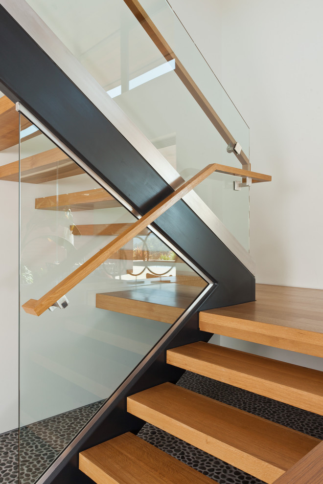 Inspiration for a large modern wooden staircase remodel in San Francisco