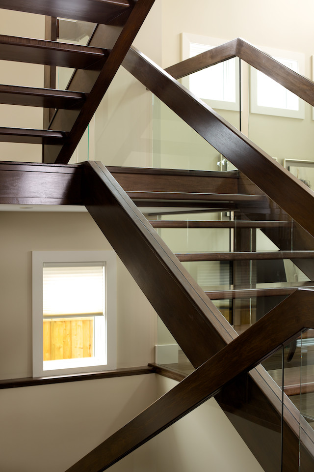 Straight maple stair with glass panel railing ...