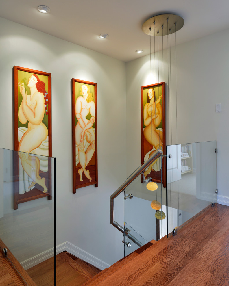 Example of a trendy wooden staircase design in Ottawa with wooden risers