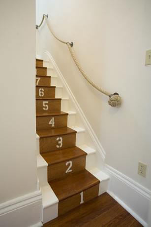 staircase rope handrail and painted numbers