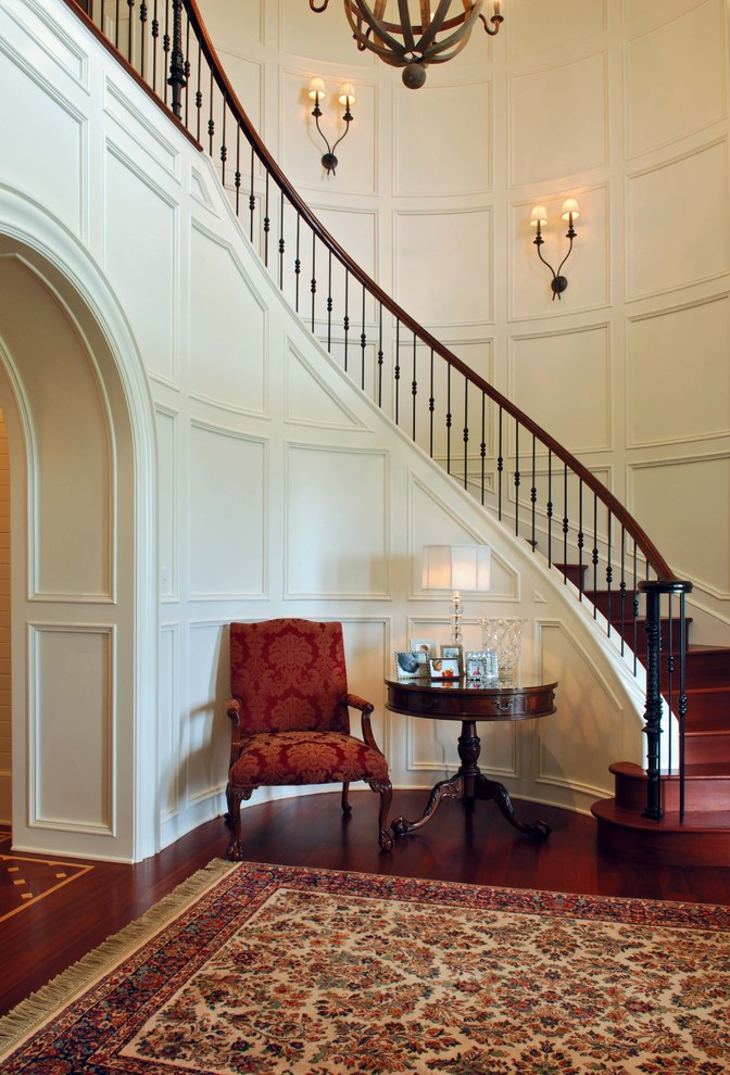 Inspiration for a wooden curved staircase remodel in Charleston